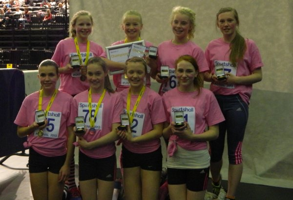 The winning Under 13 Girls' team with their gold medals